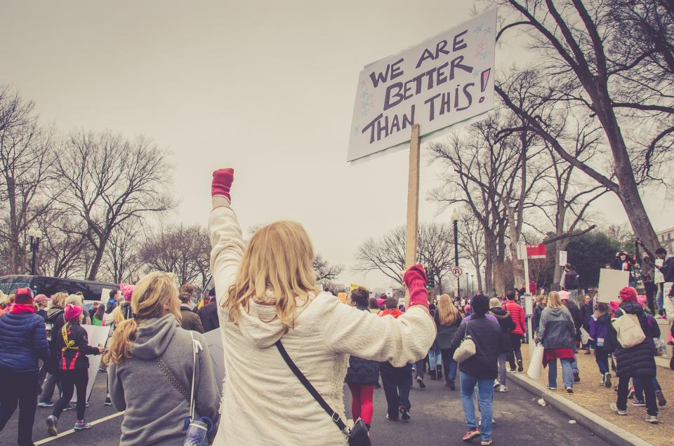 people woman rally protest unite signage banners empowerment trump government politics equality