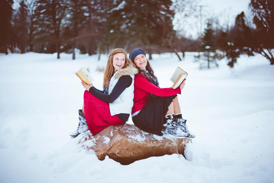 people girls lady female reading bible smile laugh happy snow winter tree plant outdoor nature cold weather
