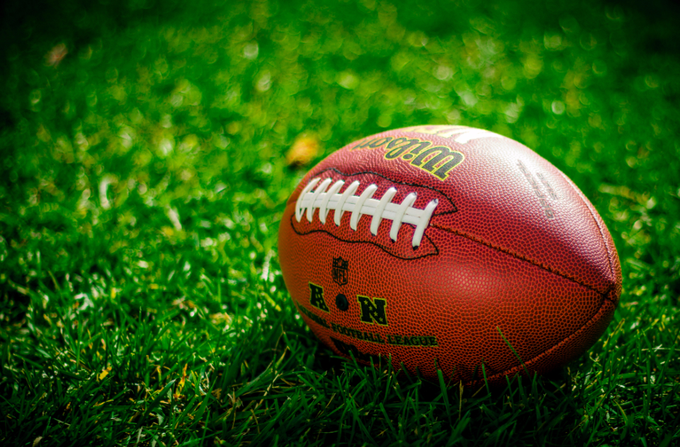sports ball football American footbal grass atheletics exercise
