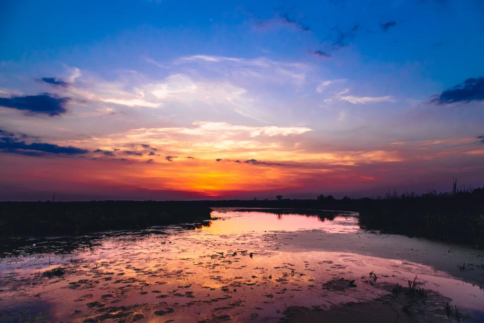 sunset dusk sky river water landscape nature clouds