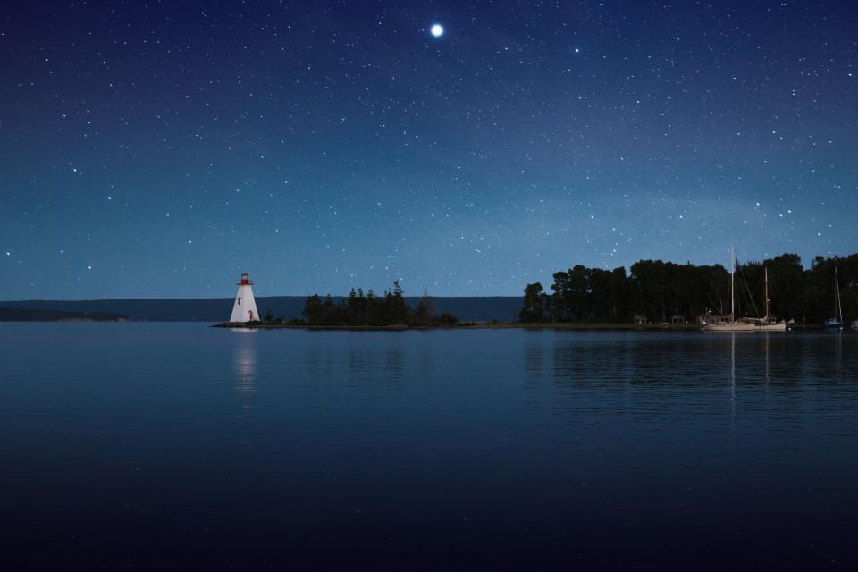 blue sky stars galaxy night trees plant nature sea ocean water horizon reflection lighthouse boat