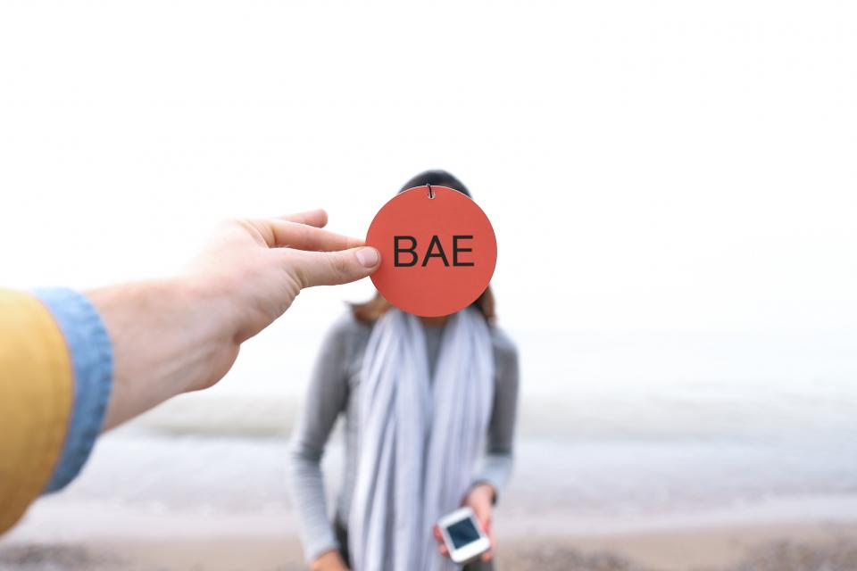 people woman girl outside travel outdoor hand arm mobile phone gadget date beach blur
