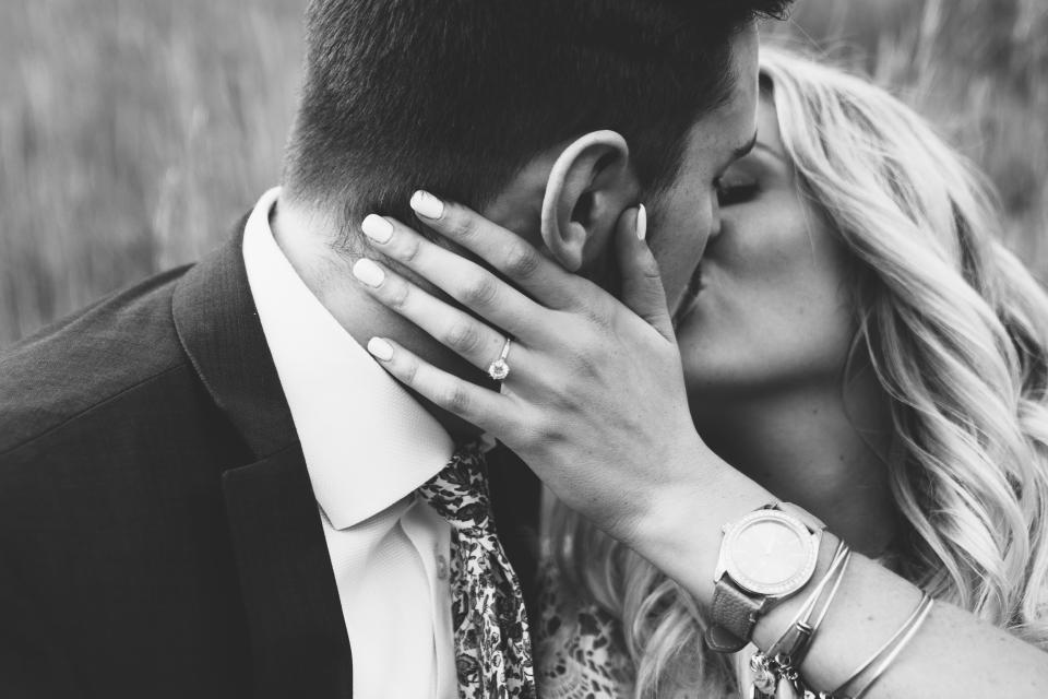bride groom girl woman guy man kissing couple romance romantic love engagement ring watch blond beauty black and white suit