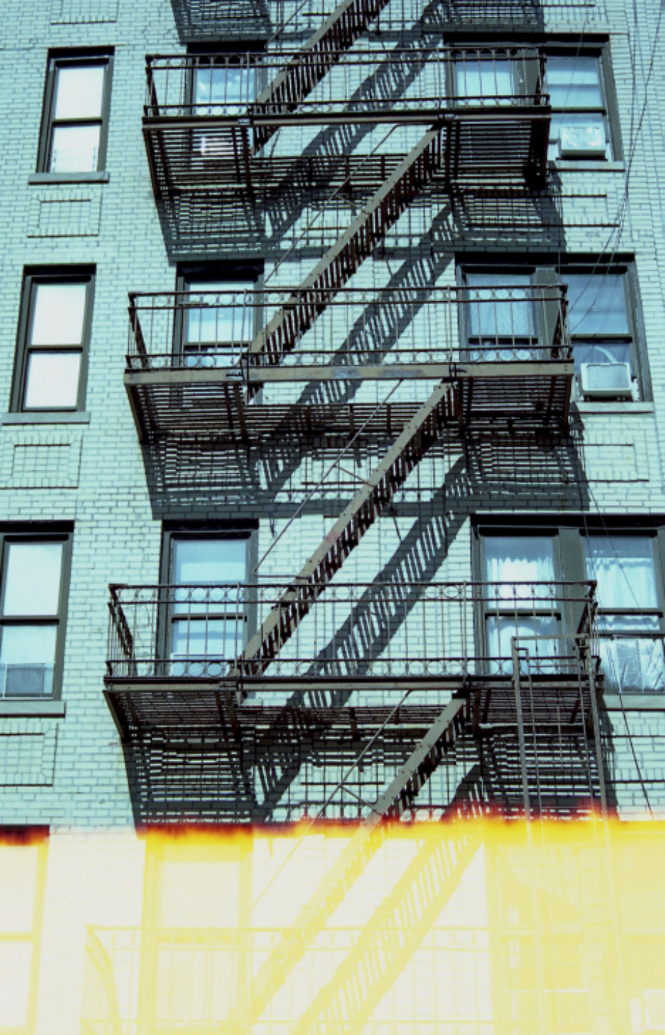 old building facades fire escape apartment nyc windows exterior lofts architecture stairs film light new york