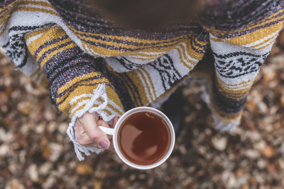 cup tea woman jumper jersey wool warm cold high view close up fashion people travel food drink coffee
