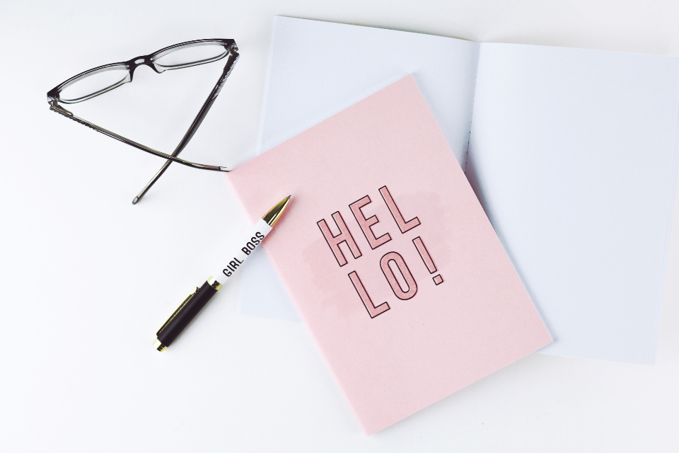 flat lay card glasses writing pen notebook desk top feminine simple clean minimal elegant objects creative design