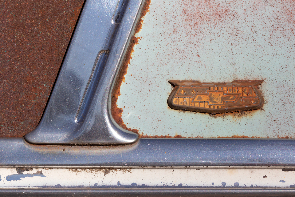 antique rust car chevy badge emblem chrome texture automotive automobile vintage aged weathered worn metal steel drive hot rod muscle car