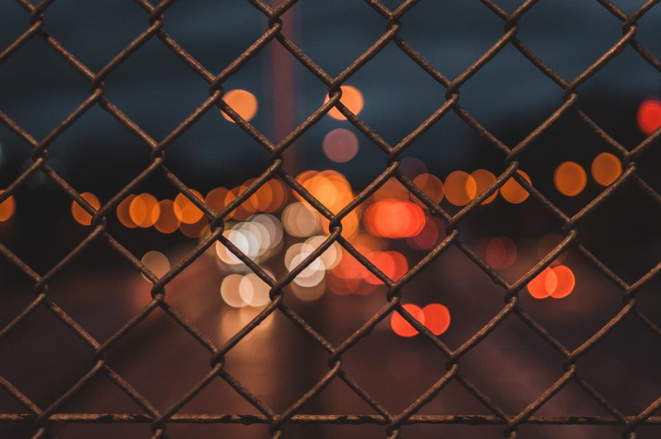 fence steel wire street road lights bokeh night blur
