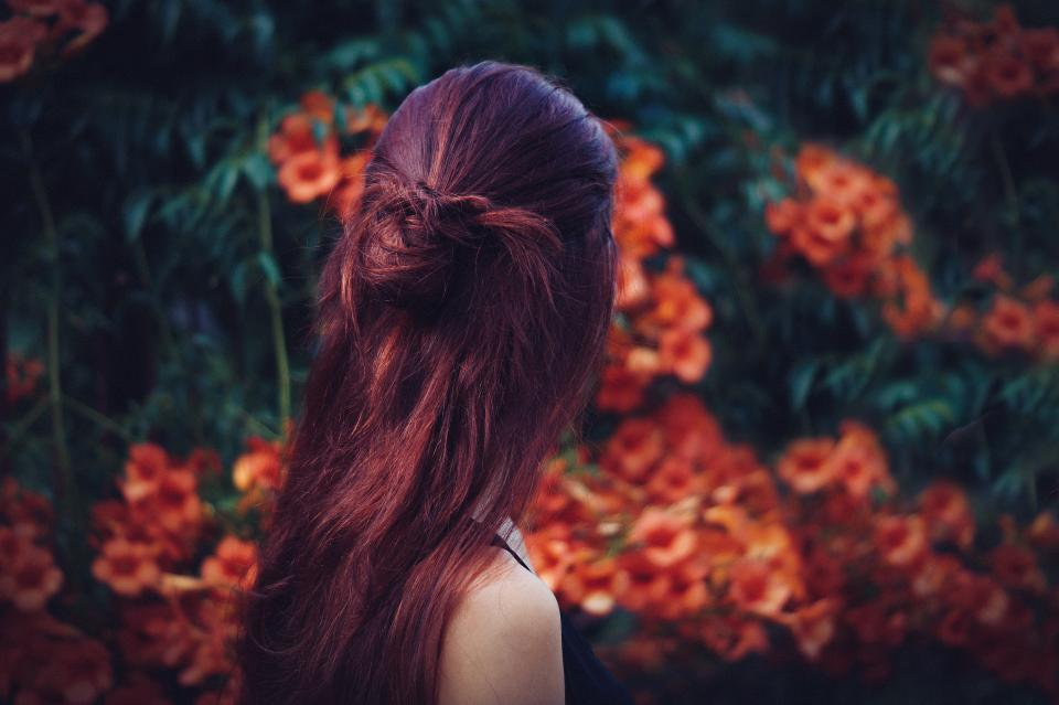 people lady woman plants flower nature leaves petals hair back shoulder bokeh blur outdoor