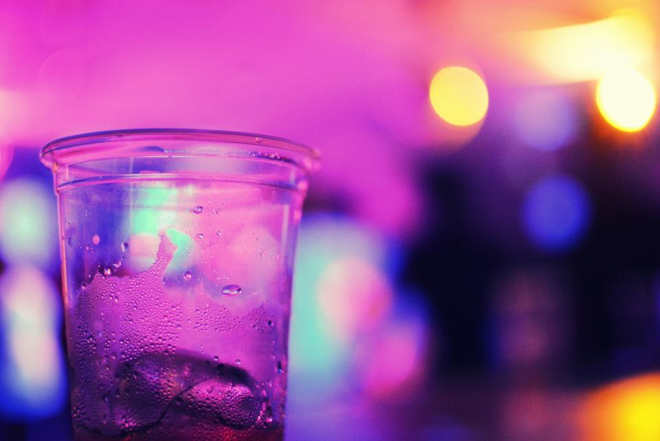 glass cup water light bokeh