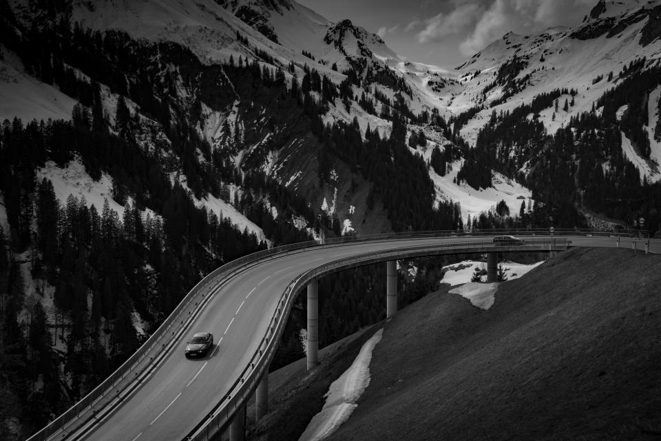 car vehicle transportation travel adventure bridge infrastructure mountain nature hike climb trek woods forest trees monochrome black and white