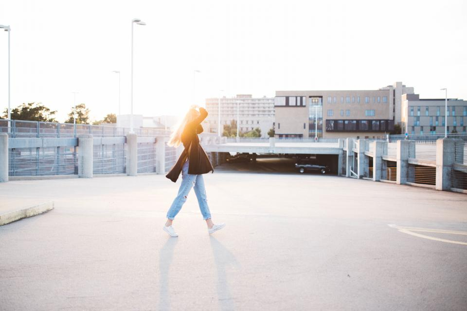 girl woman walking jeans shoes sneakers fashion parking lot sunshine sunset lifestyle people city urban model beauty
