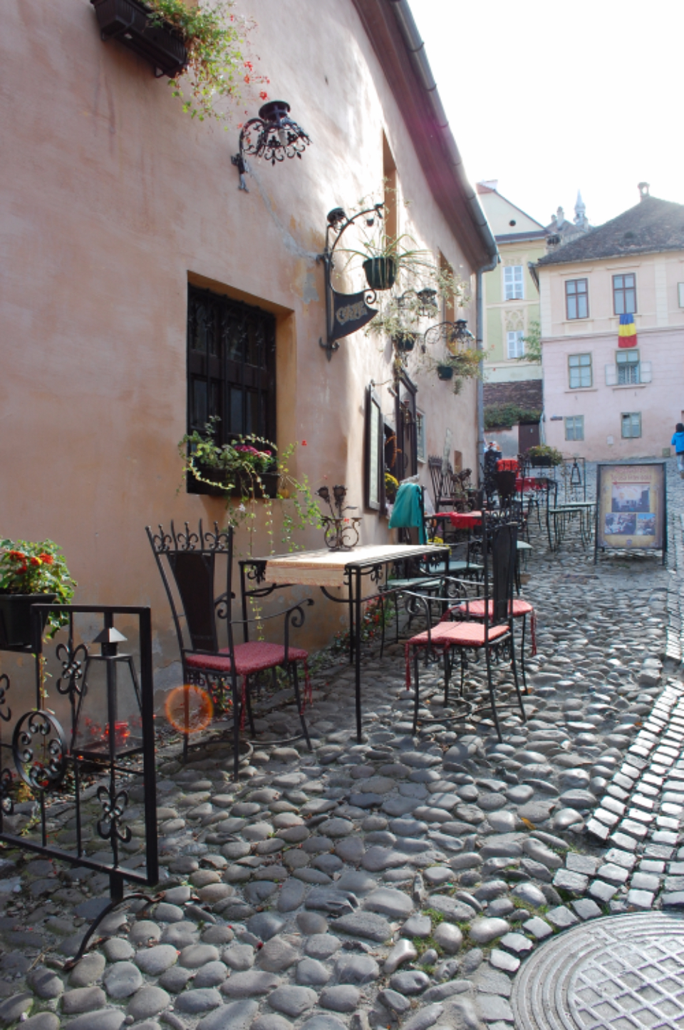 romania cafe cobbles side-street chair table coffee