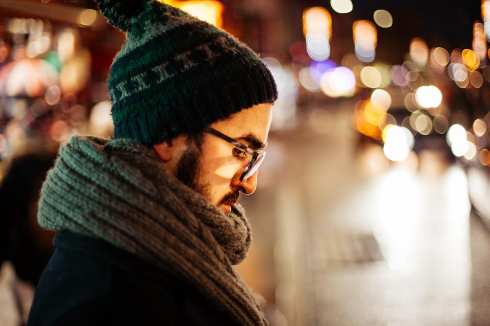 beanie scarf eyeglasses blur bokeh lights street cold people