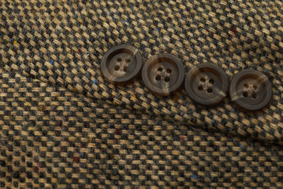 tweed suit buttons coat closeup wool design classic fashion texture button clothing fabric cloth thread retro macro