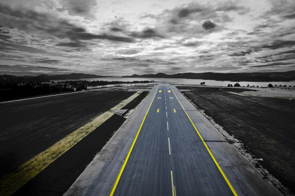 road highway fly off airplane clouds sky dark yellow lane ocean sea beach travel adventure