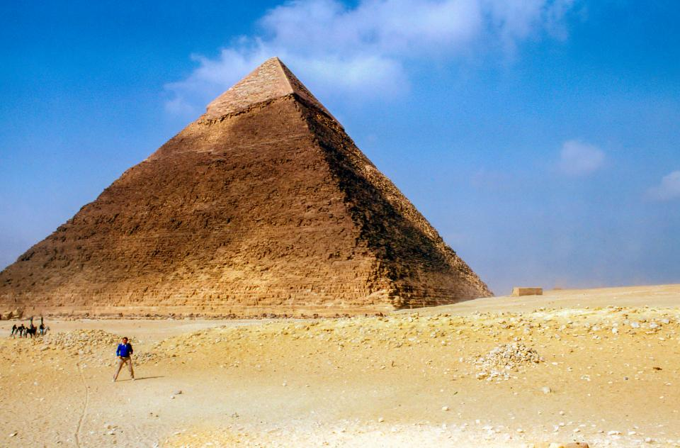 highland pyramid desert landscape blue sky clouds people man travel outdoor