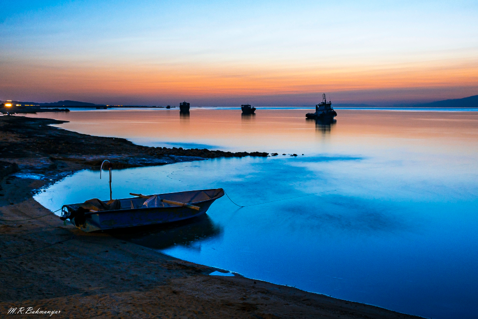 fishing boat sunset sea ocean water dusk sunrise orange blue sky rowing boat fishing boat fish calm beautiful wallpaper