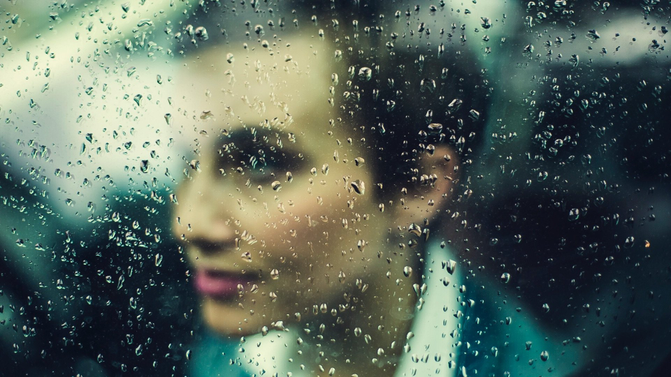 woman rain window wet bokeh transparent glass water droplets business businesswoman commute