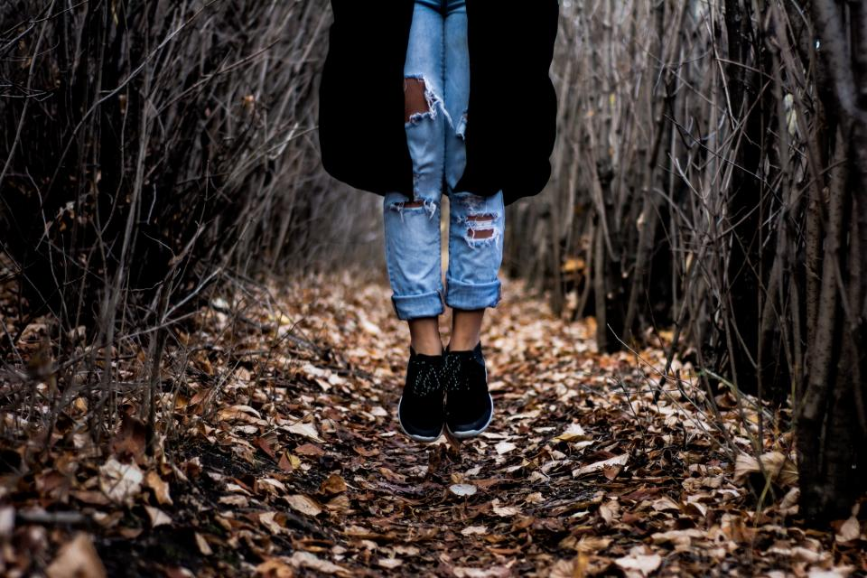 trees branches leaves fall autumn nature girl woman people jeans denim shoes fashion lifestyle