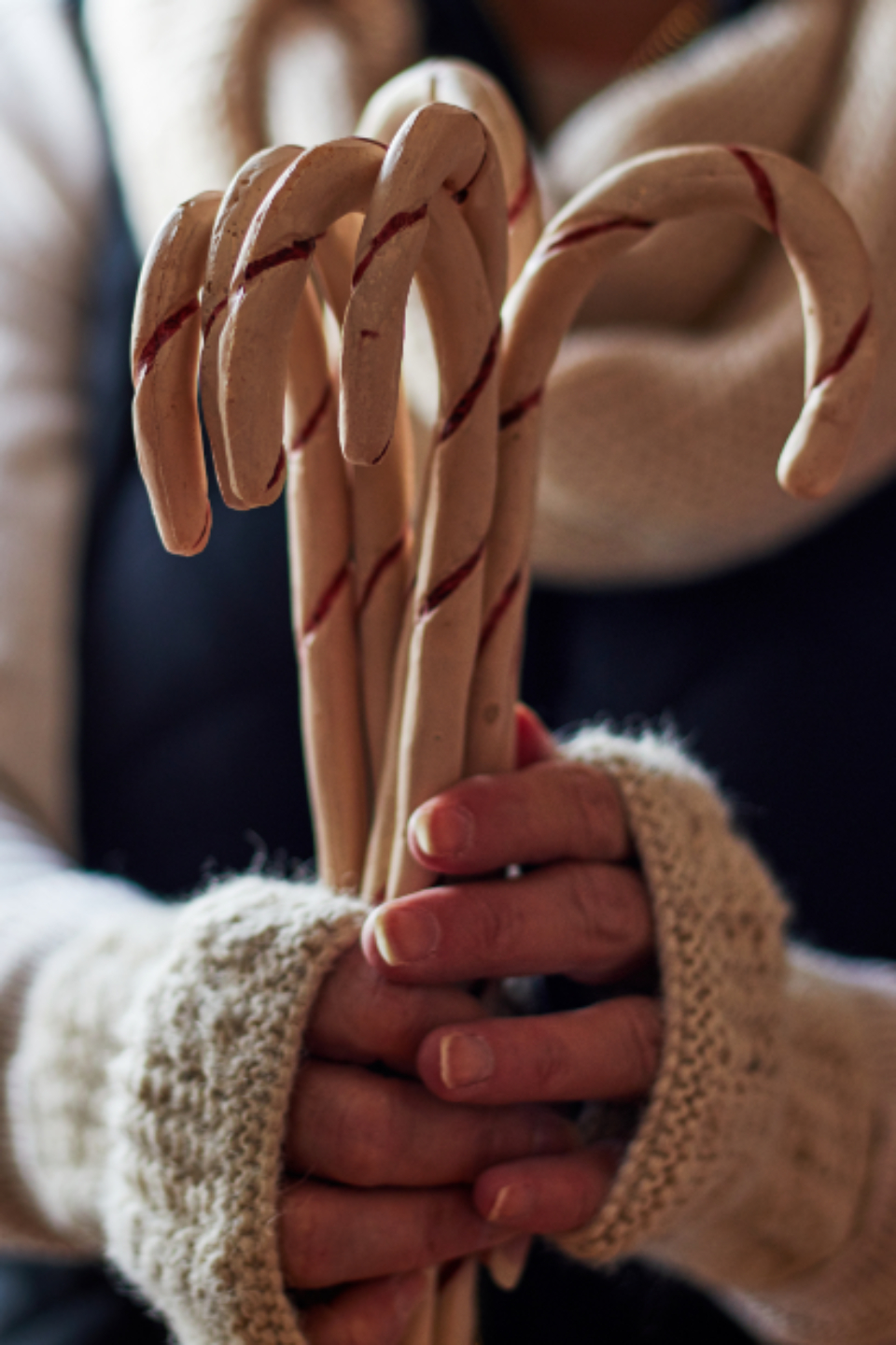 candy canes christmas peppermint sweets food holidays close up treat dessert festive holding hands cozy person gift