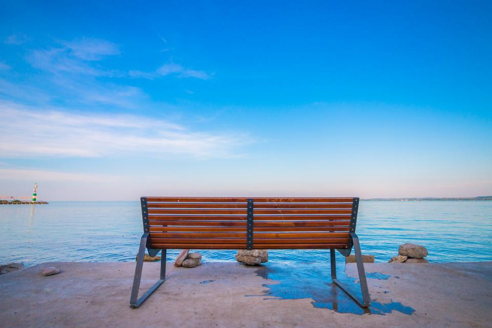 still items things bench chair dock bay rocks nature water ocean sea sky clouds horizon