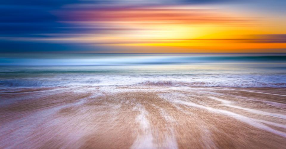 sunset sky water waves ocean sea horizon coast cloud sky view beach shore sand