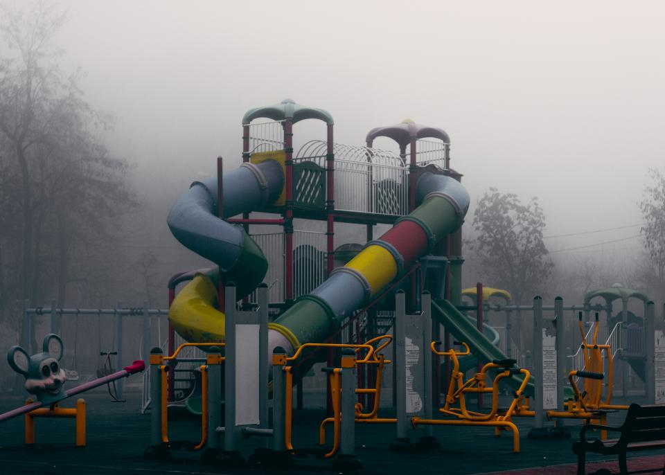 playground play structure park slides fun grey fog foggy clouds cloudy