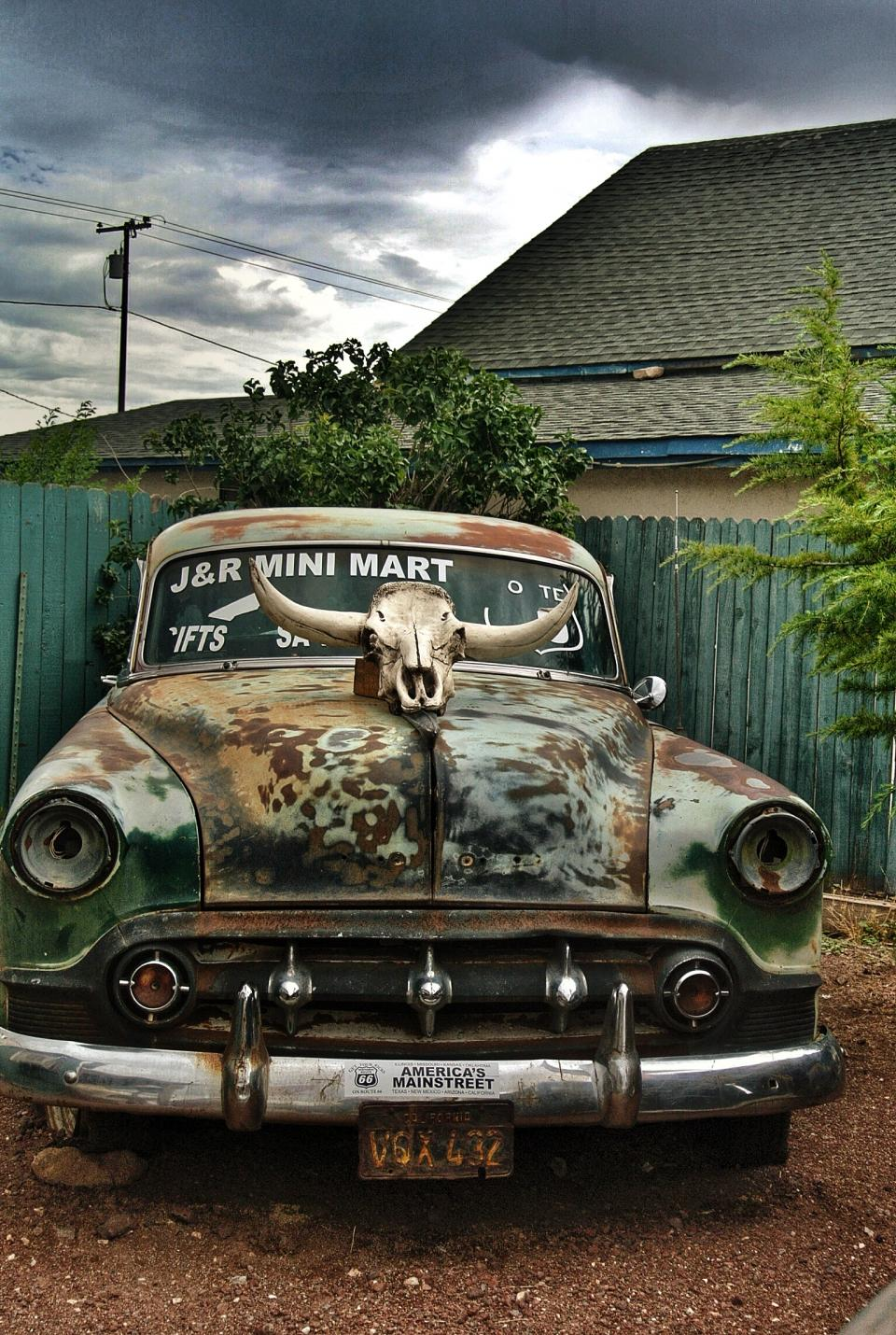 vintage car automobile automotive abandoned antique vehicle rusty outside house roof