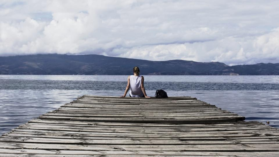 people girl woman alone relax wooden path sea ocean blue water nature mountain landscape sky clouds