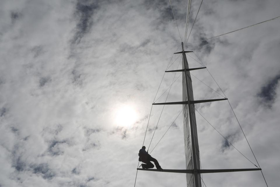 mast sailboat sailing clouds cloudy sky sun adventure outdoors people