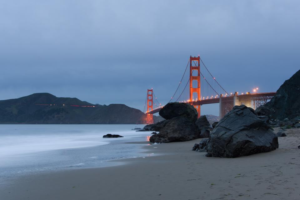 golden gate bridge infrastructure sea ocean water shore coast rocks mountain view landscape travel blue sky lights
