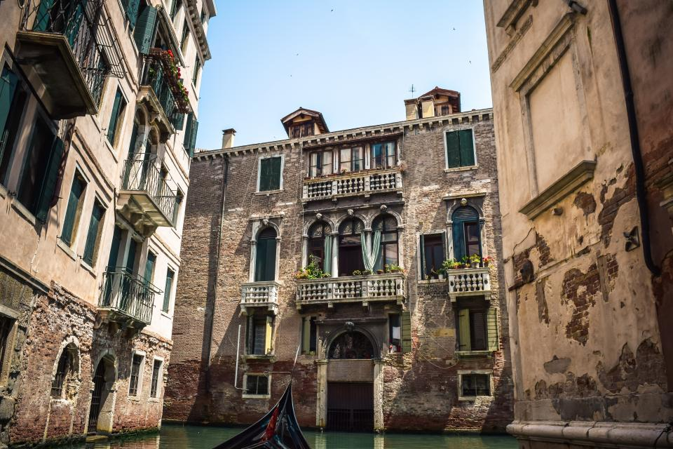 architecture building infrastructure sky window door wall sunny day canal water italy