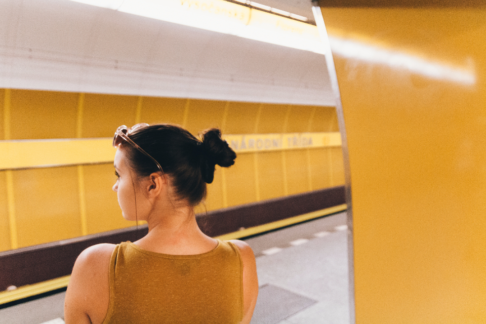 yellow colorful metro subway underground golden color girl back side portrait woman lady