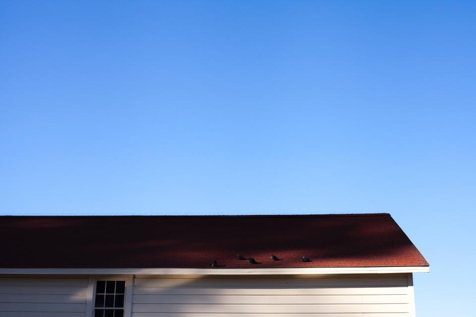 aerial house building roof blue sky
