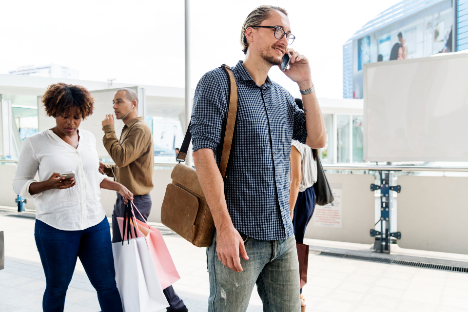 man walking talking mobile cellphone travel busy cheerful communication internet connected conversation crowd data device wireless gadget global information media casual call