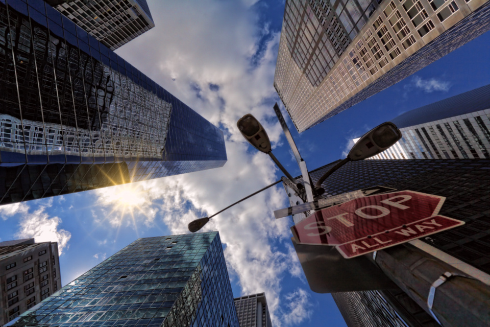 stop sign city skyscraper blue sky look up view urban glass reflection architecture