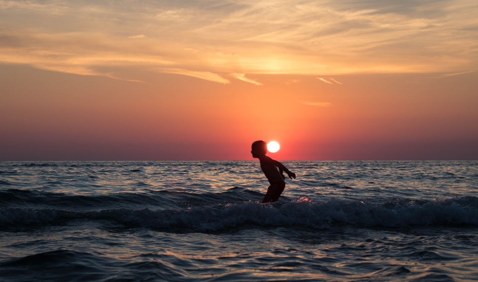 boy beach sunset vacation holiday travel child male sun ocean sea water swim play