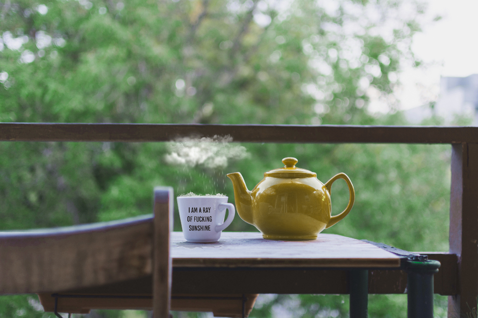 hot cup tea teapot drink food steam chair table nature house outside