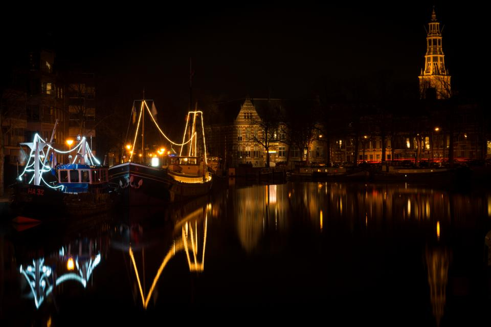 Groningen Netherlands night boats canal lights water reflection houses city town dark evening