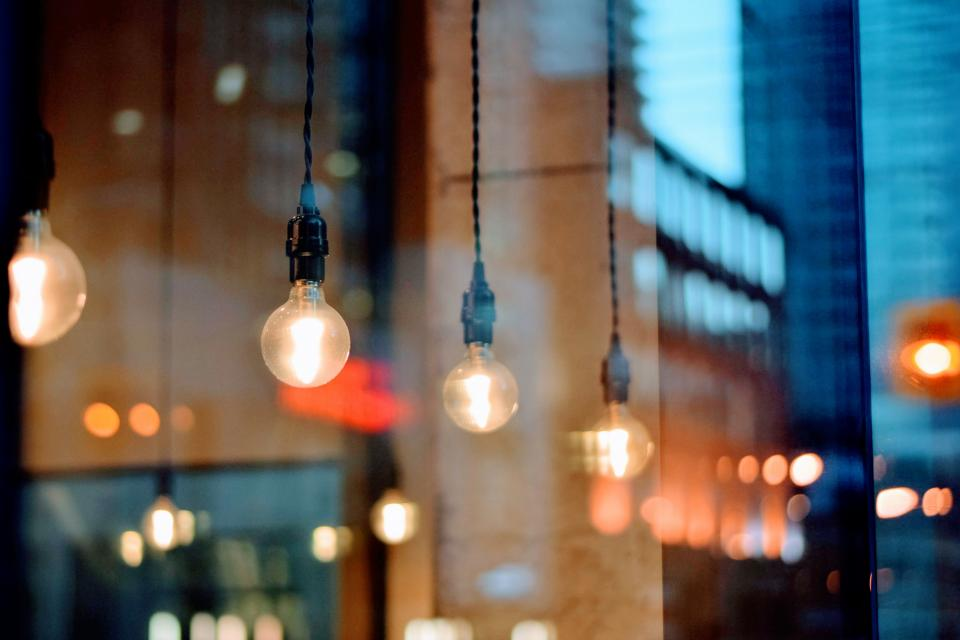 light bulb electricity buildings blur bokeh