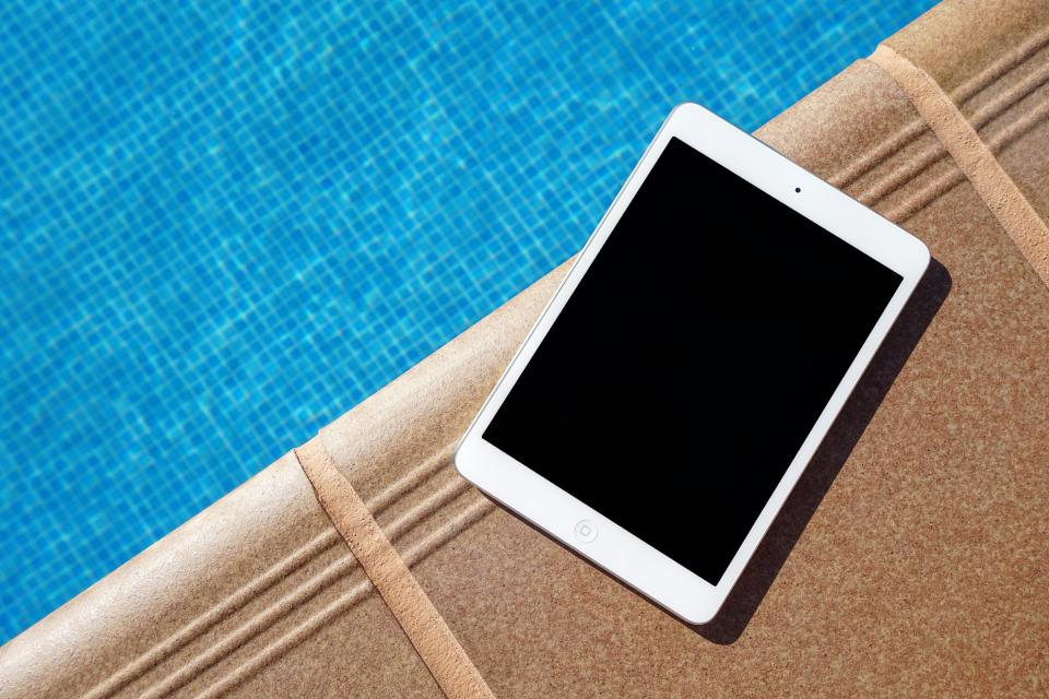 swimming pool water tablet apple ipad gadget modern technology touchscreen