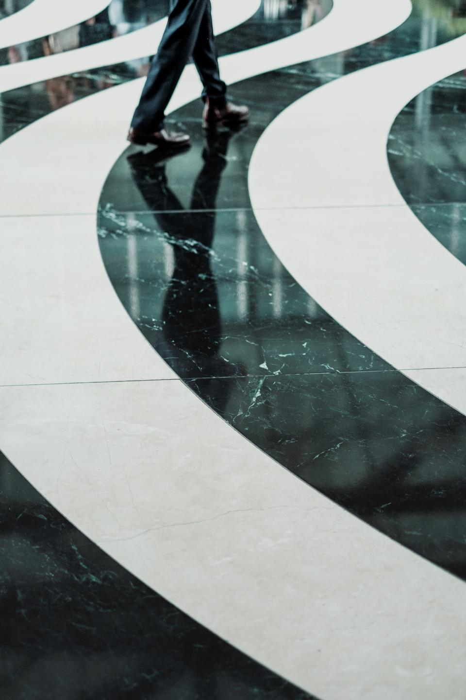 tile marble floor design people walking reflection