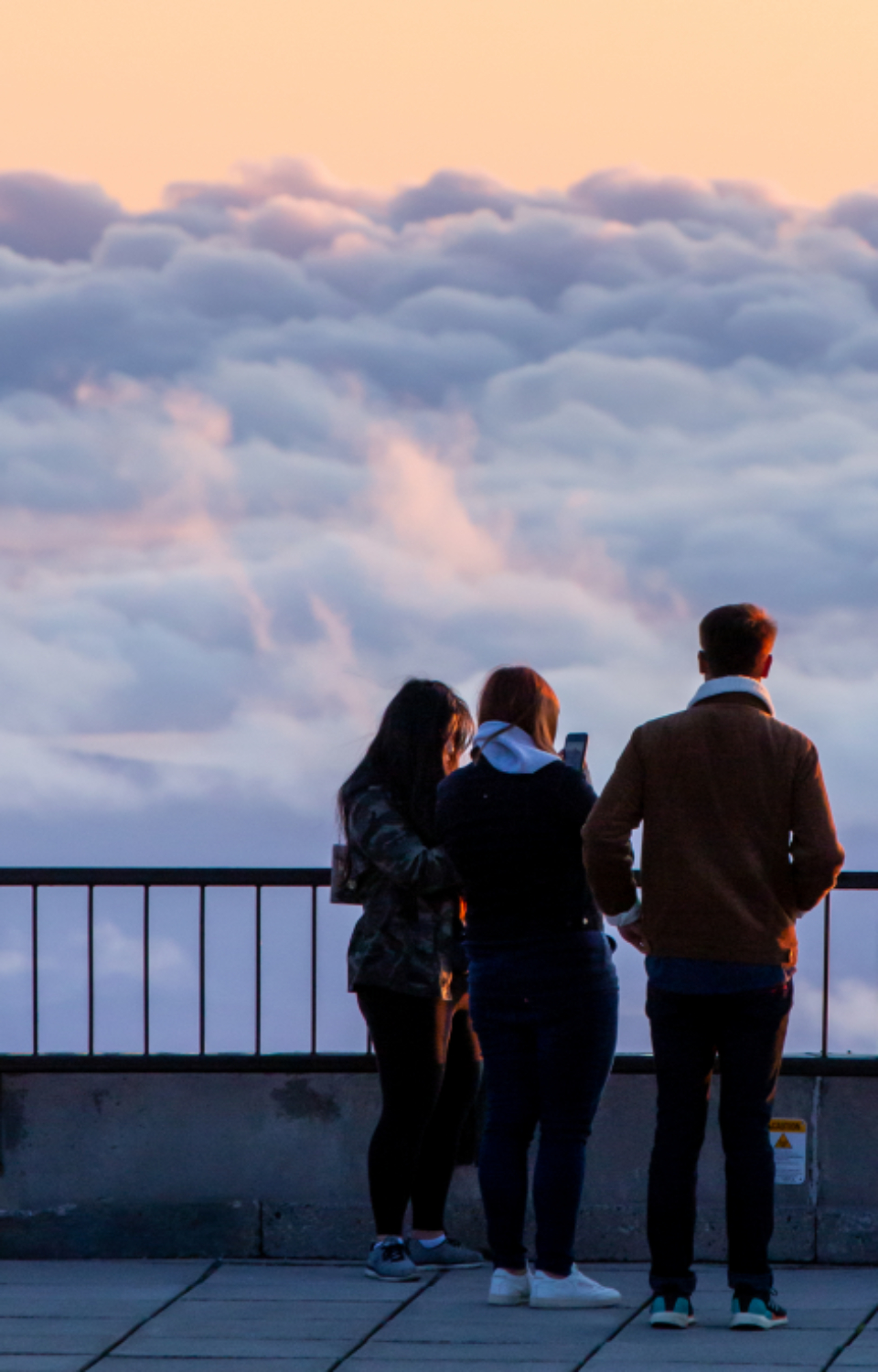 people silhouettes nature group tourists clouds travel outdoors looking sky sunset sightseeing man woman