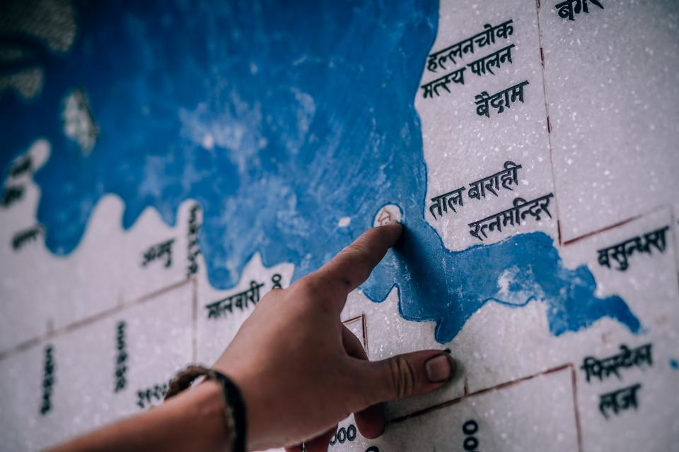 people hand travel adventure visual blue map