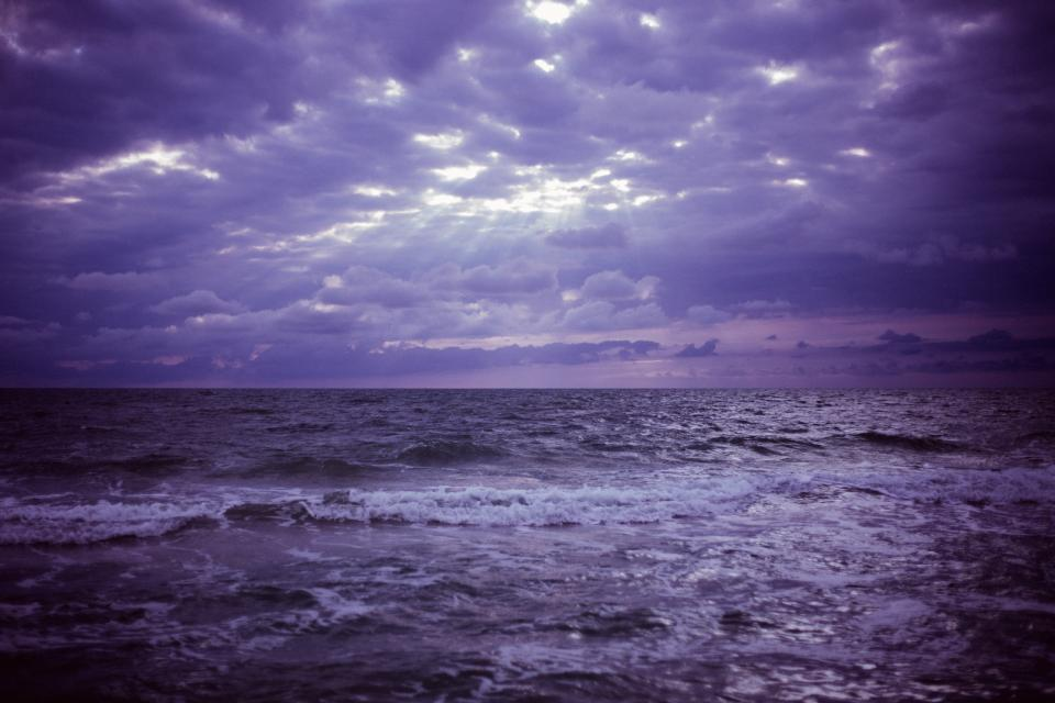 purple sky clouds storm ocean sea water waves horizon