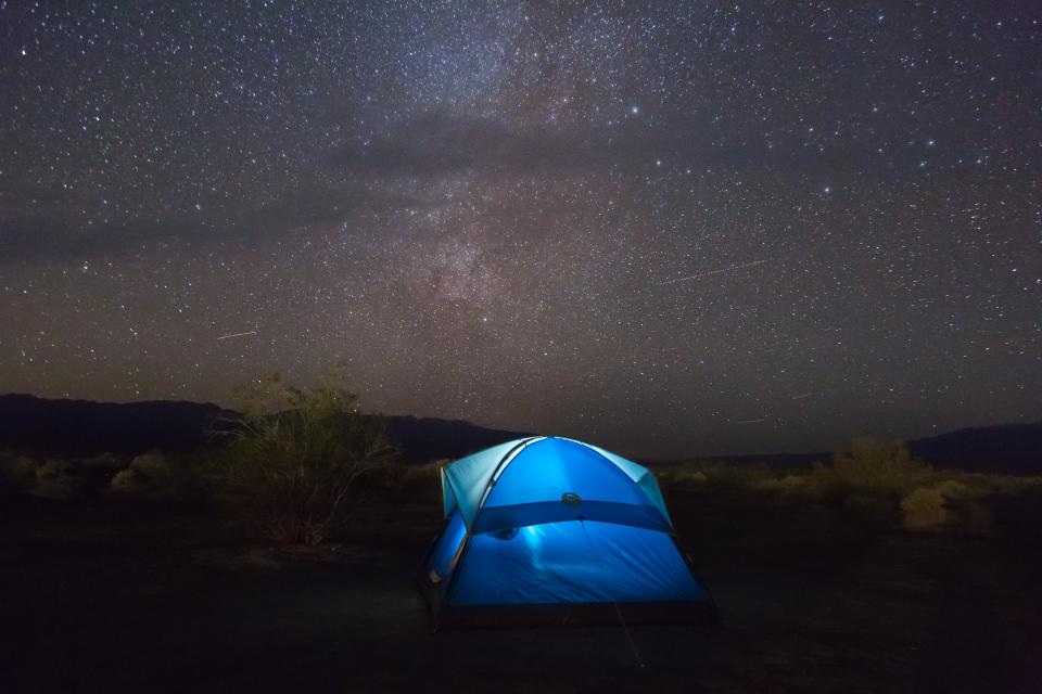 travel adventure camp tent mountain clouds sky star constellation astrophotography dark night