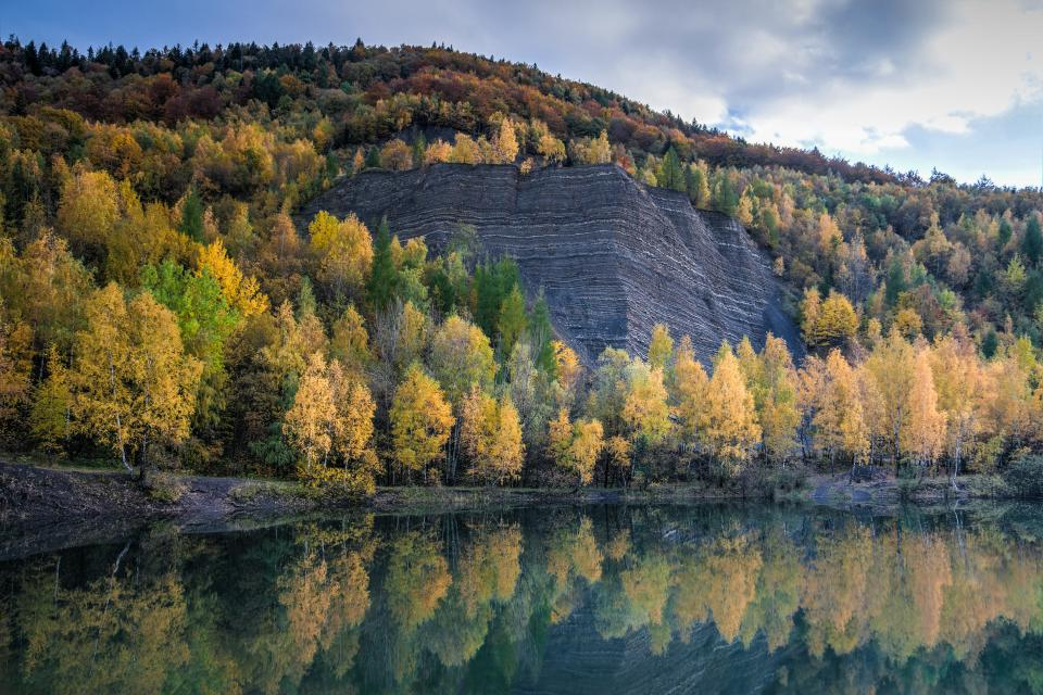 highland mountain trees plants nature landscape lake water reflection fall autumn blue sky clouds