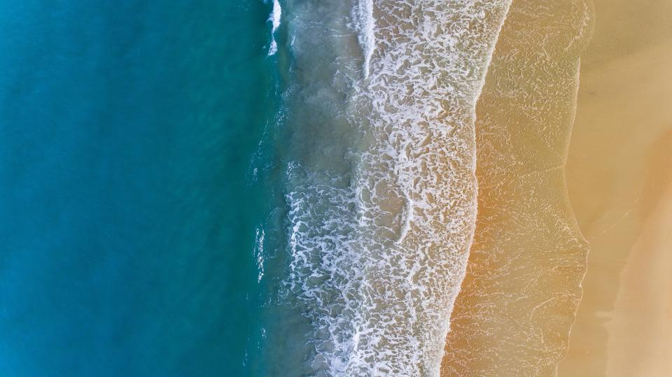 sea ocean blue water wave nature white sand shore coast beach summer travel aerial view
