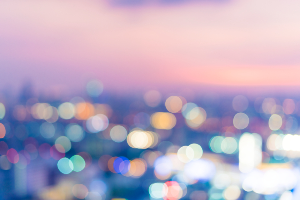 blurred bokeh buildings city cityscape dawn downtown high night pink purple roof top rooftop scene sky skyline sunset twilight view